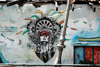 Beautiful street art on the wall of a derelict house in Cochin, India