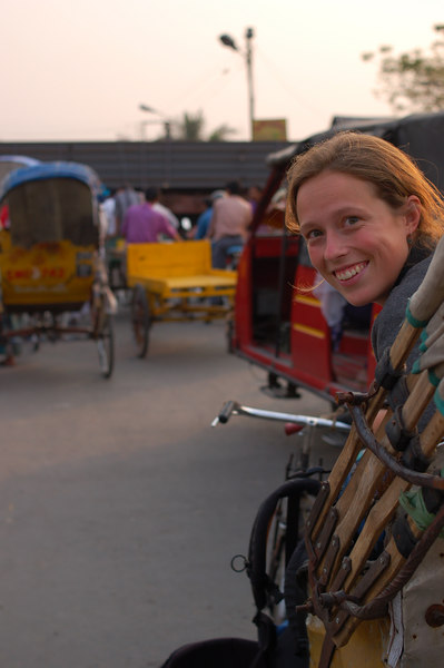 Emilie sits in the rickshaw at the train crossing
