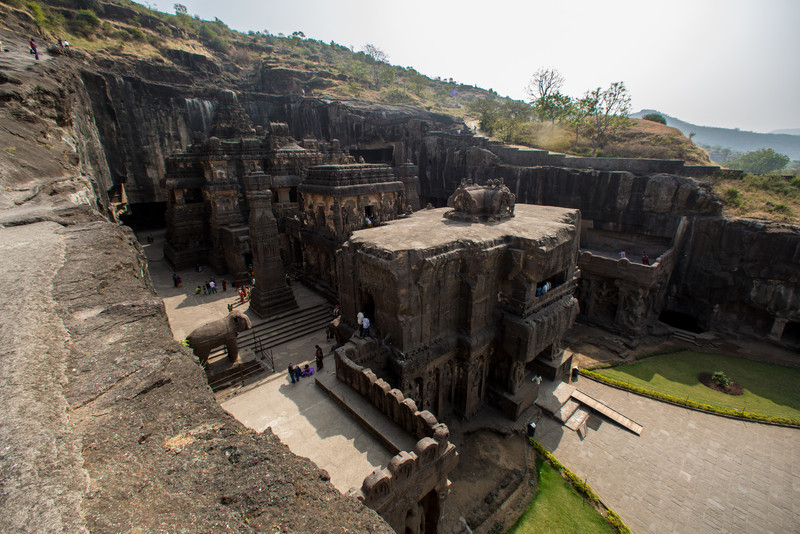 "Ellora is an archaeological site,18 mi North-West of the city of Aurangabad in the Indian state of Maharashtra built by the Rashtrakuta dynasty. Well known for its monumental caves, Ellora is a World Heritage Site and represents the epitome of Indian rock-cut architecture. The 34 ""caves"" are actually structures excavated out of the vertical face of the Charanandri hills. Buddhist, Hindu and Jain rock-cut temples, viharas and mathas were built between the 5th century and 10th century. The 12 Buddhist (caves 1–12), 17 Hindu (caves 13–29) and 5 Jain (caves 30–34) caves, built in proximity, demonstrate the religious harmony prevalent during this period of Indian history.[2]"