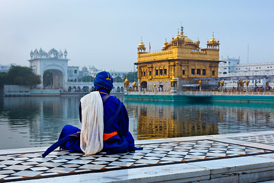 Unidentifiable Seekh Nihang warrior meditating at Sikh temple Harmandir Sahib