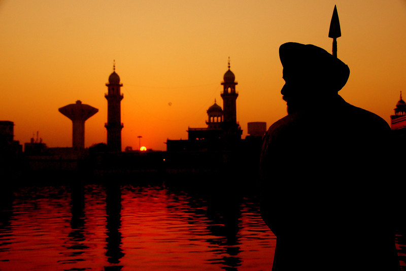 "The silhouette of a guard standing tall outside the Harmandir Sahib - Golden Temple - Amritsar, India.  This is a travel photo from Amritsar, India. <a href=""http://nomadicsamuel.com"">http://nomadicsamuel.com</a>"