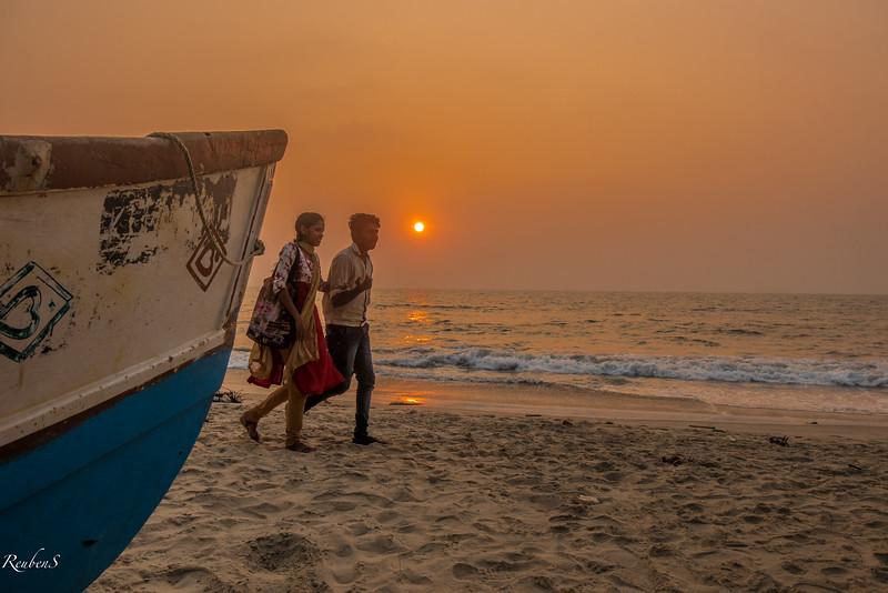 Couple at sunset at Andhakaranazhi beach, Kerela