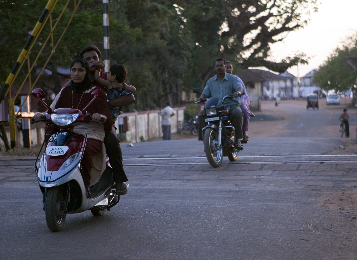 Family of three on a moped. No big deal, I still need to get a family of four with a couple of goats thrown in for good measure.