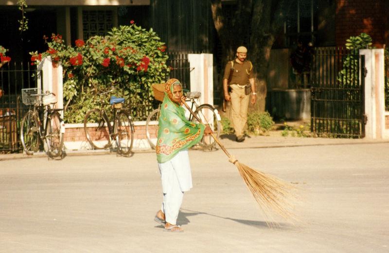 Sweeping the street, Dera, India, December 1989