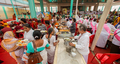 Offering of food dana at the Kalachakra grounds to the Mahasangha during the 10th Annual Tipitika Chanting Ceremony at Bodhgaya, Bihar, India.