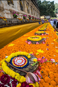 Flower decorations offered by lay devotees in honor of the Tipitika chanting program. Bodhgaya, Bihar, India.