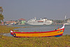 Contrasts! A colorful local fishing boat and the white Seabourn Pride in the harbor of Cochin.