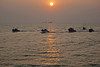 Boats coming into Cochin Harbor at sunset after fishing.