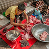 Young butcher at work, Old Delhi