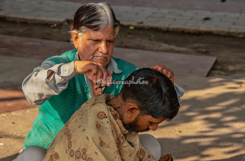 A street barber at work