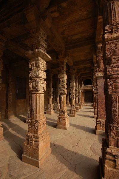 Intricately carved pillars at Qutb Minar