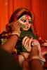 The auspicious beetlenut leaves being offered during the puja. <br /> <br /> Idol of Durga is typically too tall to reach, but her children, who are major Gods and Goddesses in their our right are within easy reach.