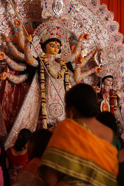 Durga Goddess appears calm after slaying the demon. Artists capture the deity in various forms, this one is most common. Sometimes she is portrayed in the act of killing when she still looks like a wild warrior enjoying her moment of triumph.