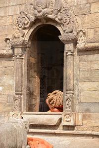sleeping sadhu near the Shiva temple in Kathmandu