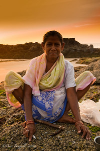 Portrait of Indian woman at sunset on Patnem Beach, Goa, India