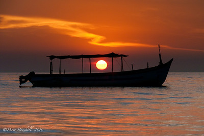 Fishing boat at sunset on Patnem Beach, Goa, India