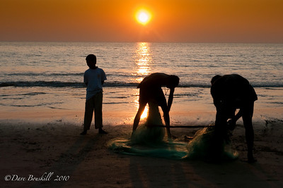 Fishing at sunset on Patnem Beach, Goa, India