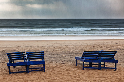 Beach chairs under rain