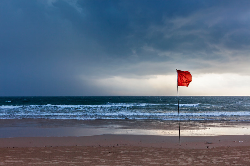 Storm warning flags on beach. Baga, Goa, India