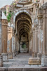 Corridor surrounding the courtyard of Jami Masjid.  Champaner, Gujarat, India<br /> <br /> The construction is ogival arches supported by pillars.