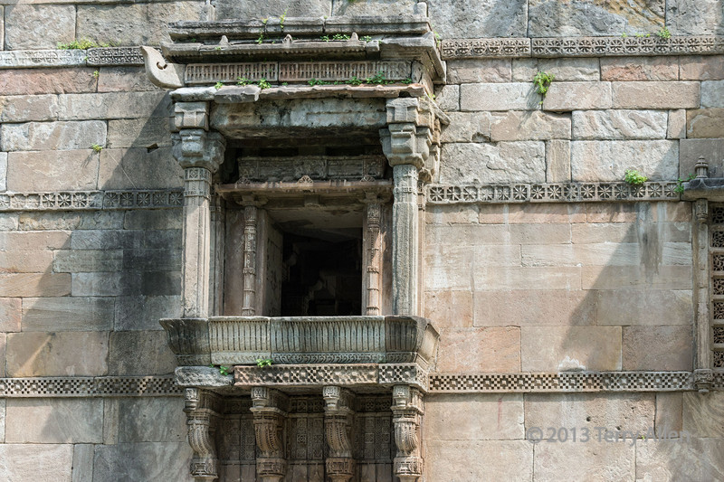 Oriel window, outer enclosure of Jami Masjib, Champaner, Gujarat, India<br /> <br /> Oriel windows are a form of bay window which project from the main wall of the building but do not reach to the ground - in this image they are supported by carved brackets
