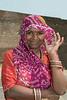Portrait of a woman in an orange sari and pink veil, Champaner, Gujarat, India