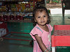 Small girl with dirty face in shop on Pavagadh Hill, Gujurat, India