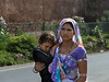 Woman carrying a sleeping child <br /> <br /> This photo was taken last week by the fortress walls when I had the opportunity to visit the UNESCO World Heritage site Champaner-Pavagadh Archeological Park in Gujurat State, west of Vadodara (formerly Baroda), India.