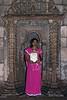 Woman in dress sari standing in mihrab in the Sahar Ki Masjid mosque, Champaner, Gujurat