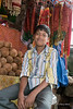 Boy sitting in shop, Pavagadh Hill, Gujurat, India