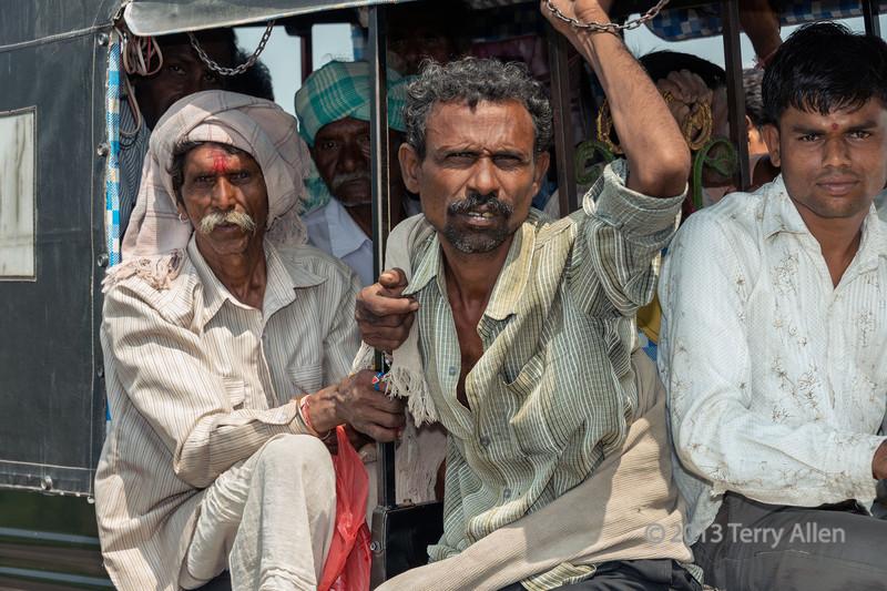 Men on local bus, Champaner, Gujarat, India