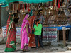 Women in colourful saris buying jewelry, Pavagadh Hill, Gujurat, India