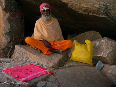 A Saddhu looks for donations at the Hampi Ruins in Karnataka India