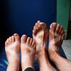 Emilie and Yann show off their sandal tans