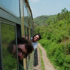 Yann and James enjoying the open windows of the toy train