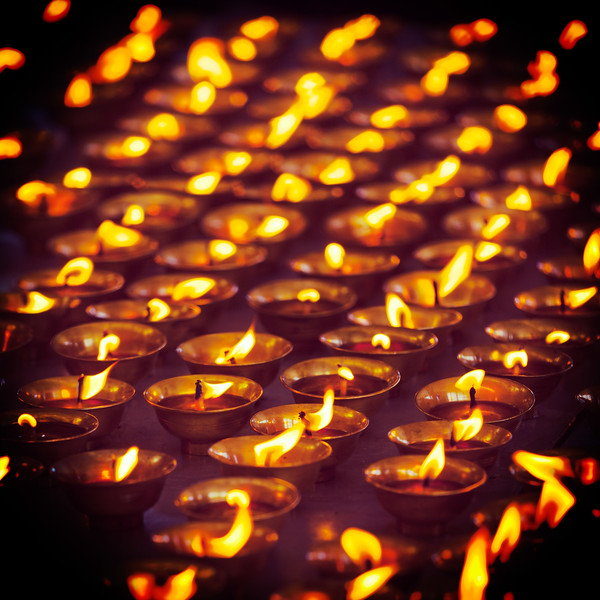 Burning candles in Buddhist temple. McLeod Ganj, Himachal Pradesh