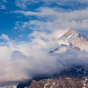 Snowcapped summit top of mountain in Himalayas in clouds