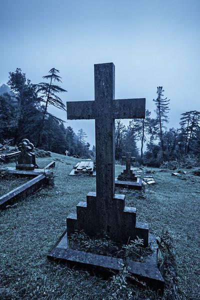 Spooky Halloween graveyard in fog