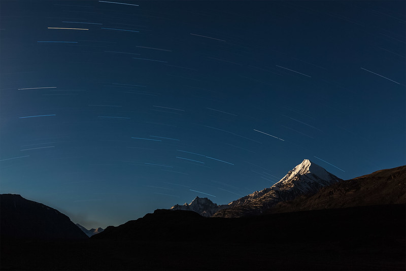 Star trails above Himalayas mountains.