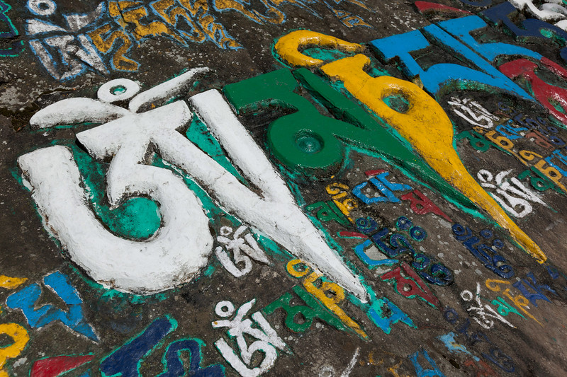Buddhist mantra on stones