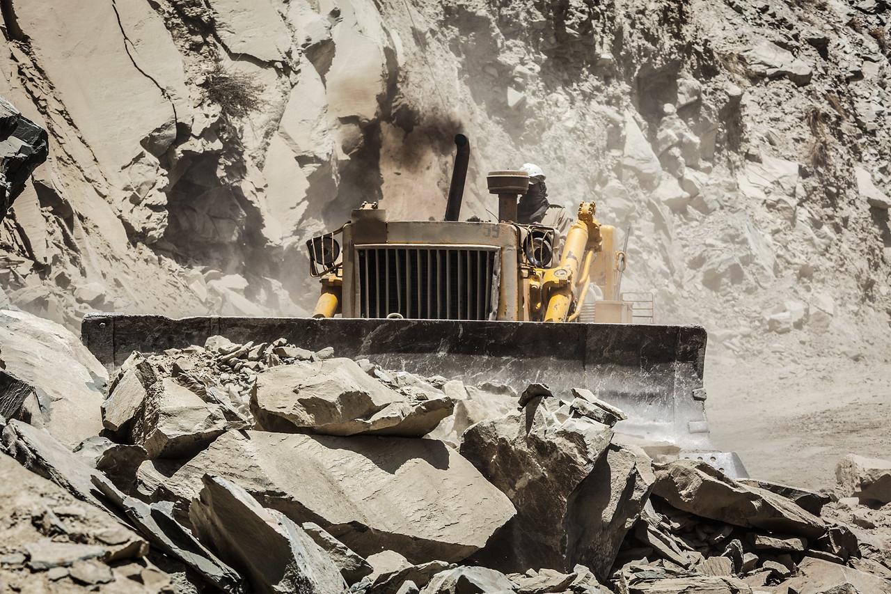 Bulldozer doing road construction in Himalayas