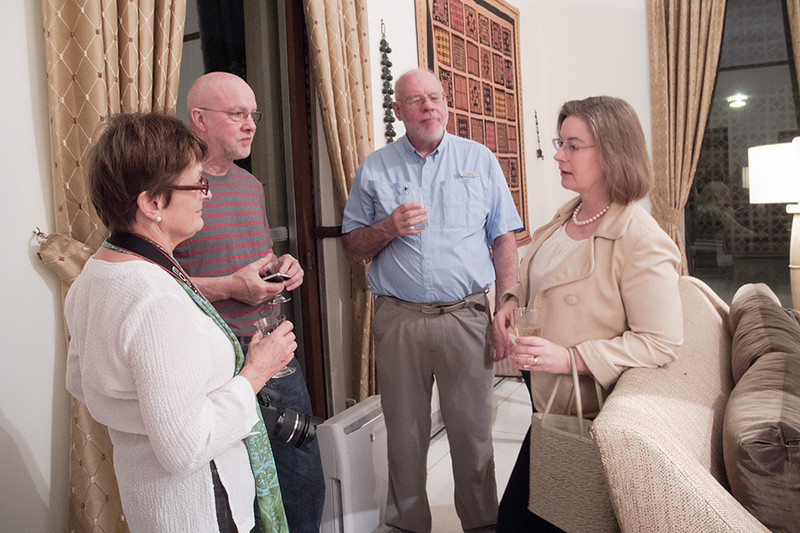 Margaret, Ken and Roger chat with one of Ambassador Powell's guests.