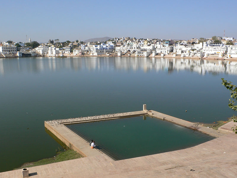 The holy lake at Pushkar. Pushkar is one of the holy sites of the Tirtha-Yatra, a travel itinerary outlined in the Mahabharata. The entire lakefront has droves of pandas, temple priests that double as tour guides.