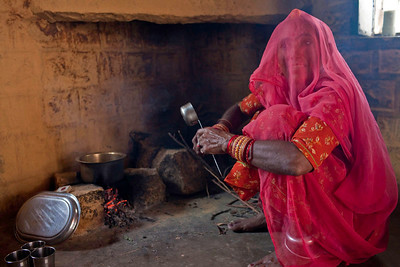 The school cook preparing tea in the kitchen