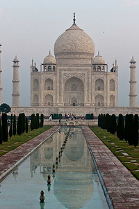 The Taj Mahal in the early morning light with the reflecting pool