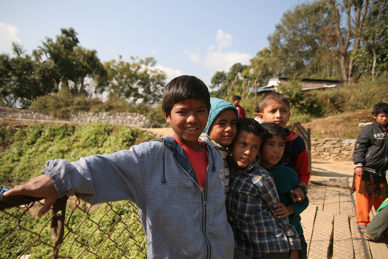 Some cool kids loitering on a bridge in Pokhara, Nepal, as their mothers wash clothes in the stream bellow.