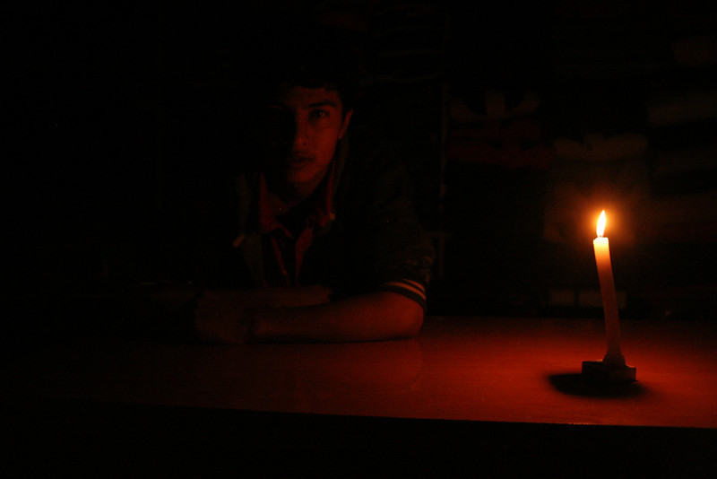 a power outage in Rishikesh, India, makes for some interesting portrait lighting.