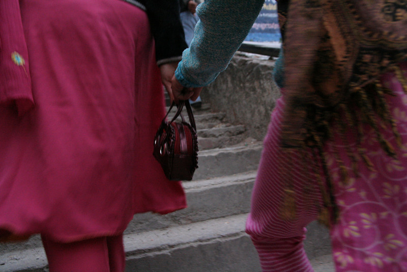 Two Indian women holding hands in Rishikesh.  In India women hold hands with women and men with other men, but hardly never between men and women.