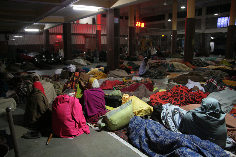 A typical scene in the lobby of an Indian train station.  So many people; so many trains.