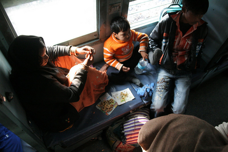 The lower deck of a train from Varanasi to New Delhi, India.  Long rides made bearable in sleeper class.